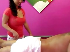 Busty asian masseuse makes client horny