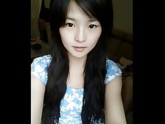 Cute chinese teen dancing on webcam