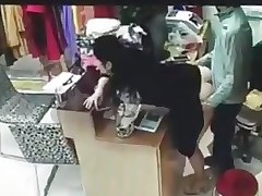 Boss has sex with employee behind cash register..